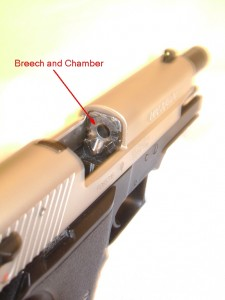 Semi-Automatic pistol with slide locked open. Breech and chamber are labeled