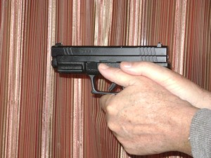 Both hands gripping a semi-automatic