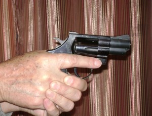 Revolver grip with two hands (trigger finger view)